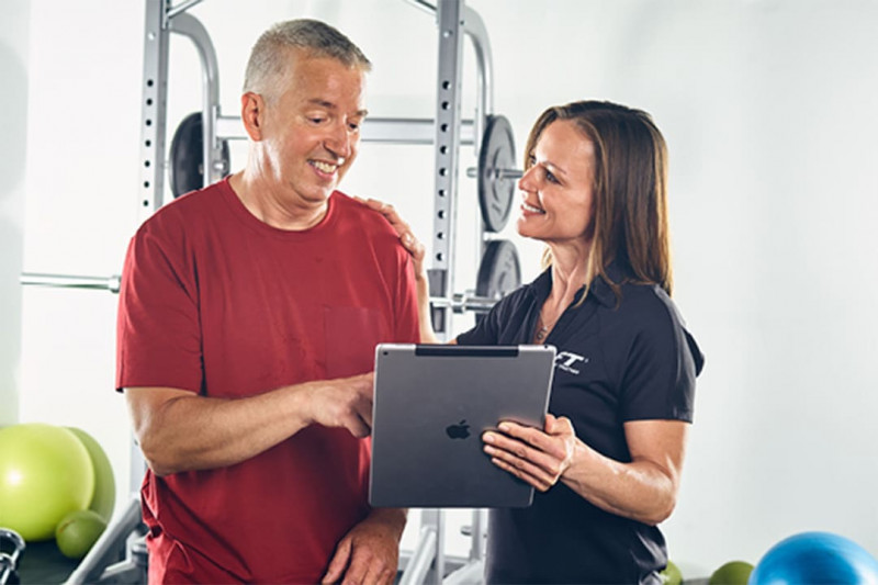 man looking at plan with personal trainer