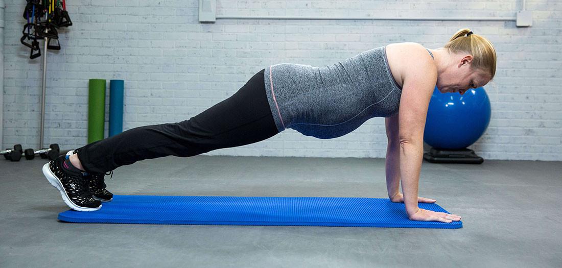 woman in prone plank position