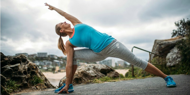 woman in yoga pose outdoors